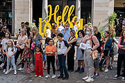 With many people and families staying in the UK for their Summer break during the school holidays, a large number of domestic tourists, who may normally have been travelling abroad, have decended on the capital to see the sights, as seen here in Covent Garden on 10th August 2021 in London, United Kingdom. Following the Coronavirus / Covid-19 health scare of the last two years, and with some travel restrictions still in place, more people have chosen a staycation which is a holiday spent in ones home country rather than abroad, or one spent at home and involving day trips to local attractions.