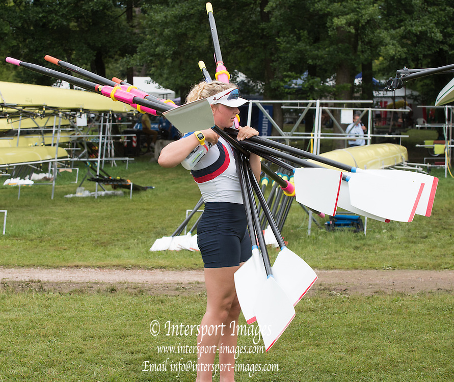Varese. ITALY.  GBR W4X, Jessica LEYDEN, carrying  an array of sculls after the morning training outing  2015 FISA World Cup II Venue Lake Varese. Thursday  18/06/2015 [Mandatory Credit: Peter Spurrier/Intersport-images.com]