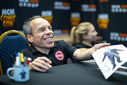 © Licensed to London News Pictures . 30/07/2017 . Manchester , UK . Warwick Davis signing photos for fans . Cosplayers, families and guests at Comic Con at the Manchester Central Convention Centre . Photo credit : Joel Goodman/LNP
