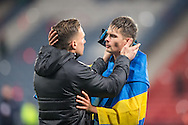 Celtic defender Mikael Lustig (right) is congratulated on winning the Betfred Cup following the Scottish Cup final match between Aberdeen and Celtic at Hampden Park, Glasgow, United Kingdom on 27 November 2016. Photo by Craig Doyle.
