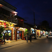 A night time street scene in Hoi An, Vietnam. Hoi An is an ancient town and an exceptionally well-preserved example of a South-East Asian trading port dating from the 15th century. Hoi An is now a major tourist attraction because of its history. Hoi An, Vietnam. 5th March 2012. Photo Tim Clayton
