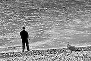 Man Fishing off the Beach,  The Stade, Hastings Old Town, East Sussex, Britain - 2010