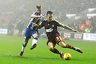 Wigan's Michael Jacobs (17) and Ipswich's Jonas Knudsen (3) during the EFL Sky Bet Championship match between Wigan Athletic and Ipswich Town at the DW Stadium, Wigan, England on 17 December 2016. Photo by Craig Galloway.