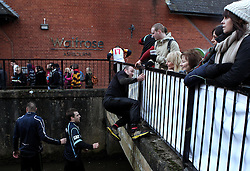 Competitors climb out of The River Dove - Mandatory byline: Robbie Stephenson/JMP - 09/02/2016 - FOOTBALL -  - Ashbourne, England - Up'Ards v Down'Ards - Royal Shrovetide Football