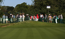 People queuing in Wimbledon Park Golf Club on day two of the Wimbledon Championships at the All England Lawn Tennis and Croquet Club, Wimbledon.