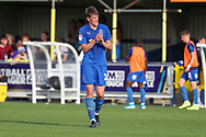 AFC Wimbledon defender Ryan Delaney (21) clapping during the EFL Sky Bet League 1 match between AFC Wimbledon and Shrewsbury Town at the Cherry Red Records Stadium, Kingston, England on 14 September 2019.
