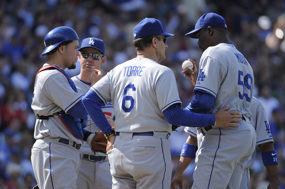 CHICAGO - MAY 30:  Manager Joe Torre #6 of the Los Angeles Dodgers makes a pitching change during the game against the Chicago Cubs on May 30, 2009 at Wrigley Field in Chicago, Illinois.  The Cubs defeated the Dodgers 7-0.  (Photo by Ron Vesely)