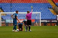 Football - 2020 / 2021 Sky Beat League Two - Bolton Wanderers vs Grimsby Town<br /> <br /> Referee Samuel Barrott shows the yellow card to Antoni Sarcevic of Bolton Wanderers, at University of Bolton Stadium.<br /> <br /> COLORSPORT/ALAN MARTIN