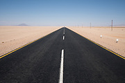 One of the most perfect stretches of road that we found in Namibia. Miles of perfect black tarmac with distinctive white markers created such geometry amongst thousands of acres of desert sand. As with most man-made things that I observed in Namibia, they all seemed slightly incongruous within such vast wilderness landscape.