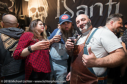 """Everybody having fun in the """"I Santi Brecia"""" booth, which as far as I can tell, was just a fun club having a fun time at the Motor Bike Expo. Verona, Italy. January 23, 2016.  Photography ©2016 Michael Lichter."""