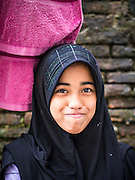 20 APRIL 2013 - BANGKOK, THAILAND:   A Muslim schoolgirl in the Haroon neighborhood in Bangkok. It is a relatively small Muslim enclave originally settled by traders from the Dutch East Indies, what is now Indonesia. PHOTO BY JACK KURTZ