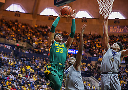 Mar 7, 2020; Morgantown, West Virginia, USA; Baylor Bears forward Freddie Gillespie (33) drives baseline and shoots over West Virginia Mountaineers forward Oscar Tshiebwe (34) and guard Miles McBride (4) during the first half at WVU Coliseum. Mandatory Credit: Ben Queen-USA TODAY Sports