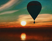 During sunset, a hot air balloon sails over the sea.<br /> Bring the atmosphere of the sea and the sense of freedom of travel into your home with a hot air balloon. This work is available in various sizes and materials. This painting easily brings the atmosphere of the sea to your home. This coastal scene can be printed in different sizes and on different materials. Both on canvas, wood, metal or framed so it certainly fits into your interior. –<br /> -<br /> BUY THIS PRINT AT<br /> <br /> FINE ART AMERICA / PIXELS<br /> ENGLISH<br /> https://janke.pixels.com/featured/a-hot-air-balloon-travels-over-the-sea-during-sunset-jan-keteleer.html<br /> <br /> <br /> WADM / OH MY PRINTS<br /> DUTCH / FRENCH / GERMAN<br /> https://www.werkaandemuur.nl/nl/shopwerk/Een-heteluchtballon-zweeft-over-de-zee-tijdens-zonsondergang/778292/132?mediumId=15&size=70x55<br /> –<br /> -
