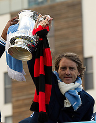 © licensed to London News Pictures. Manchester, UK  23/05/2011. Manchester City manager, Roberto Mancini. Tens of thousands of fans line the streets of Manchester as Manchester City Football Club hold an open-topped bus parade through the city. The team are celebrating winning the FA Cup, their first trophy in 35 years, and for qualifying for next season's Champions League. Please see special instructions for usage rates. Photo credit should read Joel Goodman/LNP
