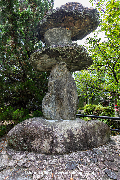 Ishidoro Stone Lantern at Ishite-ji - Temple 51 on the Shikoku Pilgrimage is one of the oldest and most beloved of all the 88 temples.  is considered to be one of the most spectacular of all the 88 temples along the trail. The sprawling Ishite-ji temple compound is composed of several halls, a three-storied pagoda and a unique inner temple connected to the main grounds via a cave. The dimly lit cave is remarkable in and of itself though dark and spooky. Ishiteji is known for its Niomon Gate, a designated national treasure.  All of these structures exhibit typicalarchitecturalstyle of theKamakura Era.