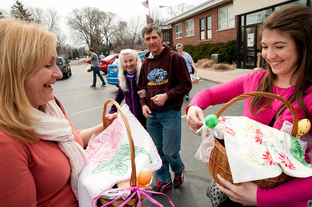 Alice Stapel and her son Doug (center) look on as her daughter Kim Pozza (L) and granddaughter Lauren Stapel (R) show off their newly-blessed baskets after a traditional Holy Saturday Blessing of the Easter Baskets at St. George Catholic Parish in south suburban Tinley Park on Saturday, March 30th. © 2013 Brian J. Morowczynski ViaPhotos..For use in a single edition of Catholic New World Publications, Archdiocese of Chicago. Further use and/or distribution may be negotiated separately. ..Contact ViaPhotos at 708-602-0449 or email brian@viaphotos.com.