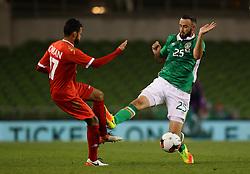 Ireland's Marc Wilson tackles Oman's Ali Sulaiman Rashid Al Busaidi - Mandatory by-line: Ken Sutton/JMP - 31/08/2016 - FOOTBALL - Aviva Stadium - Dublin,  - Republic of Ireland v Oman -