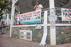 """""""Gun violence has become a health crisis in our community"""" says Celia Carroll as references the long list of homicides in the territory.  """"We need to come together for the lives of our children.""""  Virgin Islanders gear up for the 2-mile Virgin Islands Walk/Run Against Gun Violence along the Charlotte Amalie Waterfront.   Proceeds from the event go to benefit the Jason Carroll Memorial Fund for college scholarships.  St. Thomas, VI.  22 May 2016.  © Aisha-Zakiya Boyd"""
