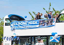 Josh Taylor victory tour, Prestonpans, East Lothian, Scotland, United Kingdom 27 June 2021: <br /> Prestonpans born world boxing champion Josh Taylor greets his fans from an open top white double decker bus in a victory lap around the town. Josh Taylor became the first  British boxer world champion in the four-belt era after defeating Jose Ramirez last month. Pictured: the victory bus sets off through the town.<br /> Sally Anderson | EdinburghElitemedia.co.uk