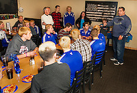 Dave Henrick owner of the 405 Restaurant hosts a pizza party for the Gilford High School soccer team on Monday evening celebrating their state championship winning season.   (Karen Bobotas/for the Laconia Daily Sun)