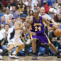 14 June 2009: Kobe Bryant of the Los Angeles Lakers dribbles against Courtney Lee of Orlando Magic during game 5 of the 2009 NBA Finals won 99-86 by the Los Angeles Lakers over the Orlando Magic at Amway Arena, in Orlando, Florida, USA. Kobe Bryant scores 30 points and leads the Lakers to15th Championship.