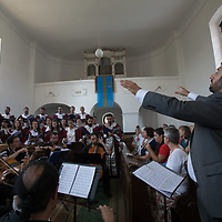 Muslim and Christian members of the Fountain of Love choir from Jordan perform their concert to praise peace together in Balatonfokajar (about 90 km South-West of capital city Budapest), Hungary on July 14, 2018. ATTILA VOLGYI