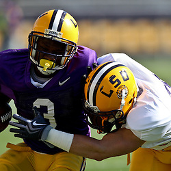 April 9, 2011; Baton Rouge, LA, USA;  LSU Tigers running back Jakhari Gore is tackled by cornerback Trent Hebert (16) during the 2011 Spring Game at Tiger Stadium.   Mandatory Credit: Derick E. Hingle