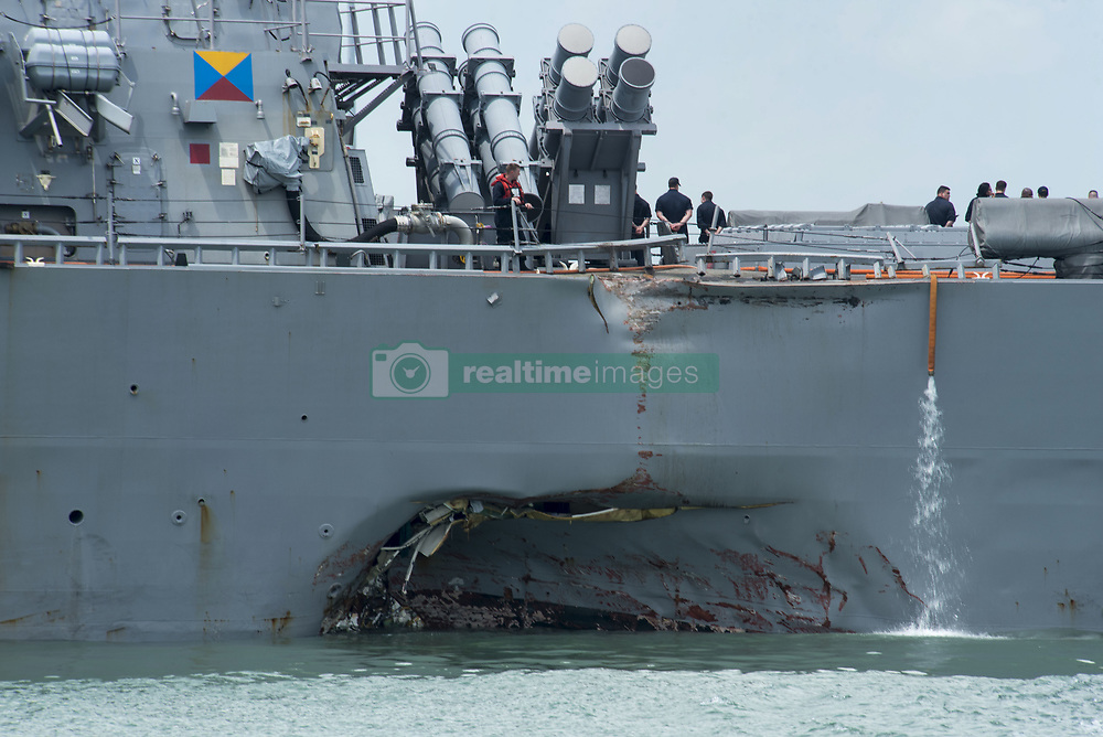 August 21, 2017 - Singapore, Singapore - The USN Arleigh Burke-class guided-missile destroyer USS John S. McCain with damage to the portside of the hull docked at Changi Naval Base for emergency repairs in Singapore. The ship collided with the civilian merchant vessel Alnic MC while underway east of the Straits of Malacca resulting in significant damage and 10 sailors missing and believed dead. (Credit Image: © Joshua Fulton/Planet Pix via ZUMA Wire)
