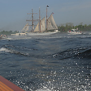 Tall ship Gazela sails up the turbulent Piscataqua River in Portsmouth, NH , near the old Naval Shipyard Prison.