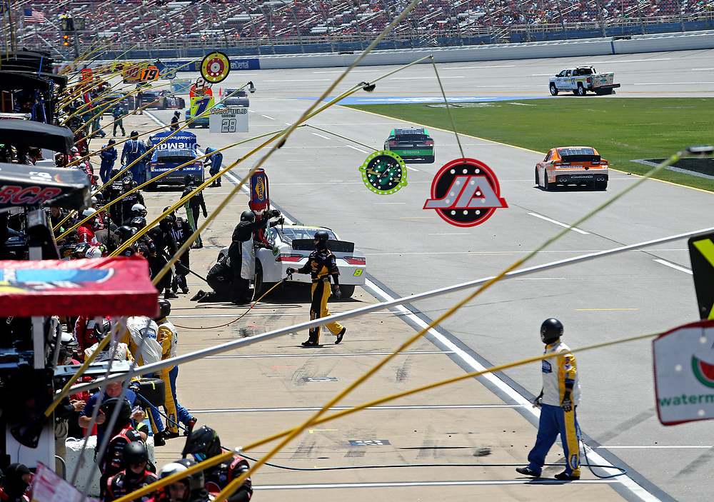 May 6, 2017; Talladega, AL, USA; Drivers make pit stops during the Sparks Energy 300 at Talladega Superspeedway. Mandatory Credit: Peter Casey-USA TODAY Sports