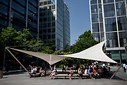 Bishop's Square in Spitalfields, a shopping and market district in the City of London. Popular also as a hang out for city workers on their lunch breaks. At the end of 2005, after 18 years of sensitive preparation, the Spitalfields regeneration programme was completed. This regeneration has resulted in the creation of two new public spaces, including Bishops Square.