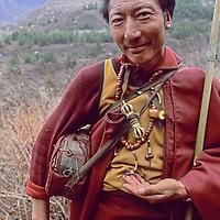 CHINA, TIBET, Tsangpo Gorge.  Tibetan Buddhist lama on pilgrimage to sacred waterfall in this deep Himalayan canyon.