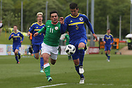 Stefan Rankic of Bosnia and Herzegovina (5) beats Sean Brennan of Republic of Ireland (11) to the ball during the UEFA European Under 17 Championship 2018 match between Bosnia and Republic of Ireland at Stadion Bilino Polje, Zenica, Bosnia and Herzegovina on 11 May 2018. Picture by Mick Haynes.
