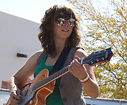 Laura Kepner-Adney plays guitar for the Silver Thread Trio during their concert at Fiesta en el Barrio Viejo 2010, Tucson, Arizona.