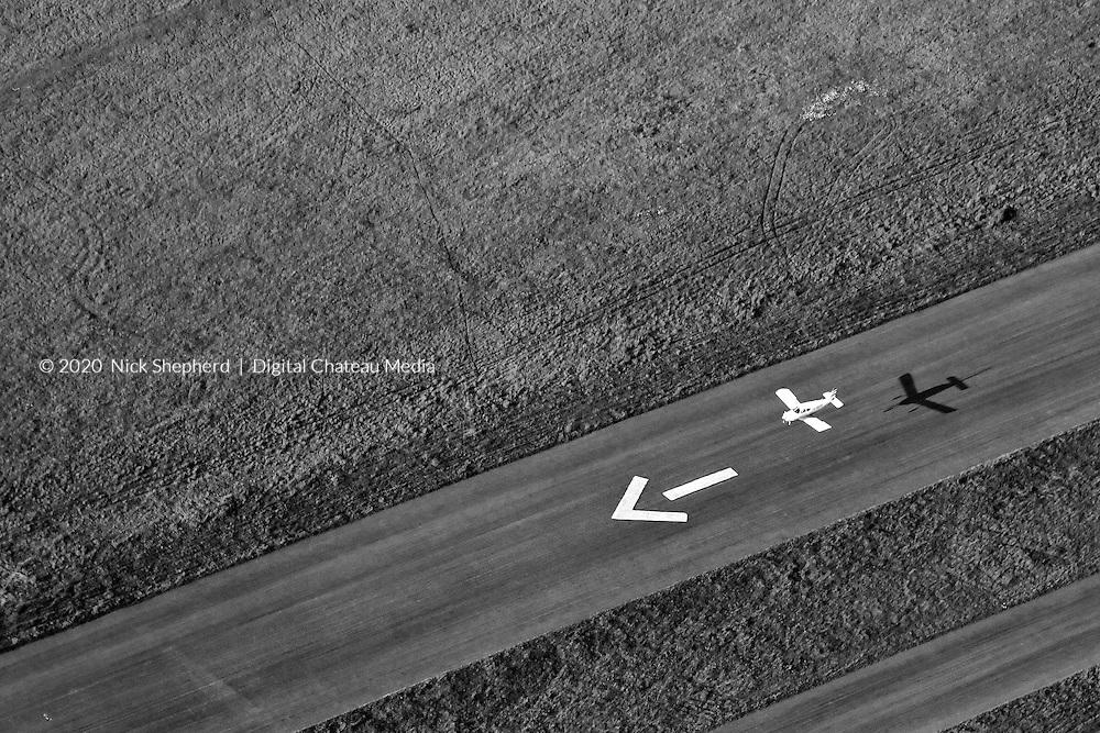 Light Aircraft Landing On Grass