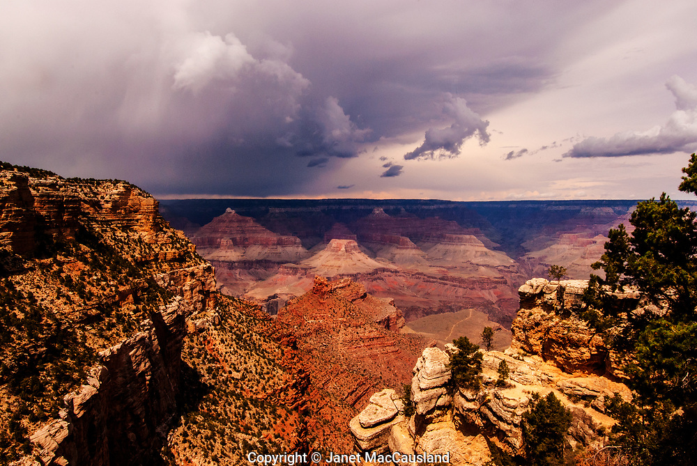 This image shows the Bright Angel Trail below from about 1/3 of the way down along the same trail to the river. Clouds are gathering in the northwest over the canyon. The trail continues well below the Green Gardens area where the trail cuts through.