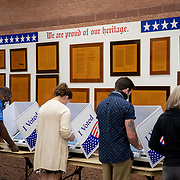 NORTH CHARLESTON, SC - OCT 16: Voters cast their ballots in the voting booths at the early vote location at the  Charleston Coliseum and Convention Center in North Charleston, South Carolina on October 16, 2020. Many states across the country have seen record turnout for early voting for the 2020 election.  (Photo by Logan Cyrus for AFP)