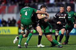 Owen Farrell of Saracens takes on the London Irish defence - Photo mandatory by-line: Patrick Khachfe/JMP - Mobile: 07966 386802 03/01/2015 - SPORT - RUGBY UNION - London - Allianz Park - Saracens v London Irish - Aviva Premiership