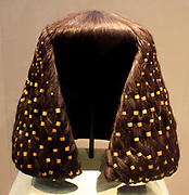 Large and small tubular wig ornaments.  12 Dynasty, reign of Senwosret 11 - Amenemhat 111 (ca 1887-1813 BC) Gold modern wig.