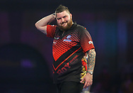 Michael Smith shows disappointment and gestures during the 2019 William Hill World Darts Championship Final at Alexandra Palace, London, United Kingdom on 1 January 2019.