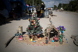 Alongside provisional shelters that stretch for miles outside San Pedro Sula, Diana's neighbour put up a Christmas tree and nativity scene on the roadside.<br /> <br /> The Christmas tree is a reminder that the global scientific community and faith-based groups across the world call out together for us all to take urgent action to slow climate change: to stop burning fossil fuels, and to start planting trees, a trillion trees need to be planted to absorb carbon from the atmosphere.<br /> <br /> And the nativity scene is a powerful reminder of Mary and Joseph who found no room at the inn and were forced to shelter and sleep with animals, the least suitable place imaginable for the birth of a baby. No one made room for them. We are all innkeepers today, deciding whether we have room for strangers, and whether we should help people who - like Mary and Joseph - have nowhere to go.