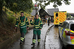 © Licensed to London News Pictures. 16/09/2016. Watford, UK. Emergency services are in attendance for passengers outside Kings Langley rail station following the derailment by a landslide of a train bound for London Euston. Passengers were transferred to a rescue train and exited at Kings Langley.  Apart from one person who suffered whiplash, there were no other reported injuries. Photo credit : Stephen Chung/LNP