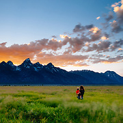 Heather and Micah Goodrich watch the sunset and bison in Grand Teton National Park Wyoming.
