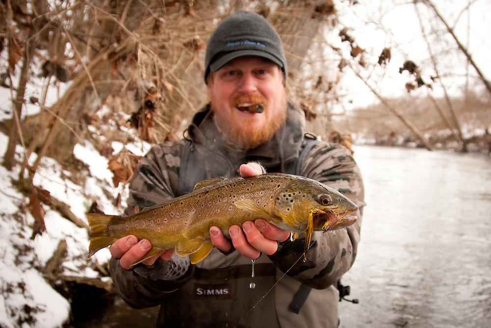 Fly Angler Mike Schmidt of Angler's Choice Flies holds a brown trout that was fooled by one of his streamers.