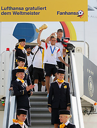 15.07.2014, Flughafen Tegel, Berlin, GER, FIFA WM, Empfang der Weltmeister in Deutschland, Finale, im Bild Philipp Lahm (GER) verlaesst mit dem WM-Pokal das Flugzeug // during Celebration of Team Germany for Champion of the FIFA Worldcup Brazil 2014 at the Flughafen Tegel in Berlin, Germany on 2014/07/15. EXPA Pictures © 2014, PhotoCredit: EXPA/ Eibner-Pressefoto/ Pool<br /> <br /> *****ATTENTION - OUT of GER*****