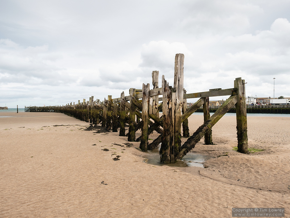 The Derelict North Jetty Exposed At Low Tide, Amble, Northumberland