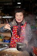 Woman at the Jagalchi Fish Market, Busan, South Korea, Republic of Korea, KOR, 15 February 2010.