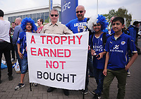 Football - 2015 / 2016 Premier League - Leicester City vs. Everton<br /> <br /> Leicester City fans with a banner Trophy earned , not bought at the King Power Stadium.<br /> <br /> COLORSPORT/ANDREW COWIE