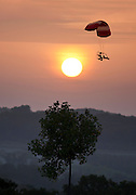 Man in a Powered Parachute Flying Over the Ozark Mountains at Sunrise