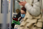 People are seen wearing face protective masks throughout London underground stations on Wednesday, April 8, 2020 -  as the UK continues in lockdown to help curb the spread of the coronavirus. (Photo/Vudi Xhymshiti)